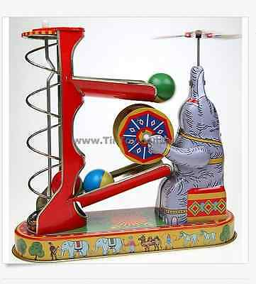 Wind - up Elephant Playing with Balls Retro Tin Toy Collectable