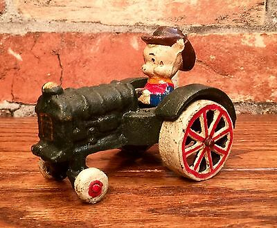Cast Iron Farmer Porky Pig on Tractor Vintage Looney Tunes Cartoon Toy