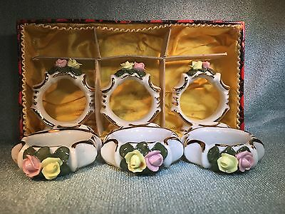 VTG  Gold Trimmed 6 CERAMIC FLOWERS Footed NAPKIN RINGS IN ORIGINAL BOX