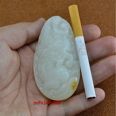 Chinese Hetian white jade hand-carved dragon amulet pendant
