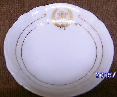 Nine (9) China Butter Pats Trimmed in Gold with Gold lettering Appears to be FBC