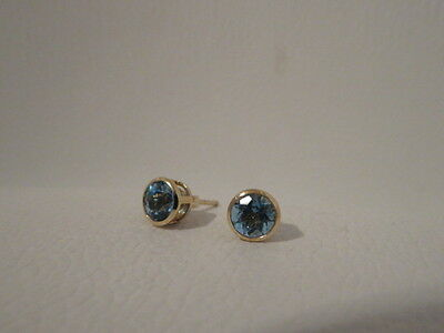 14K stamped gold studs with blue stone
