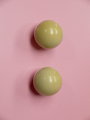 A gorgeous pair of mid century round ball bakelite /plastic door knobs - cream