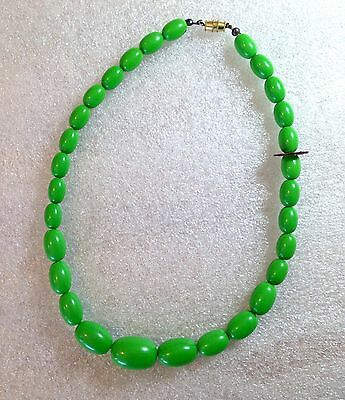 Vintage early plastic green necklace made in Hong Kong - bakelite style