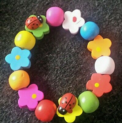 GIRLS.Childrens Wooden Bracelet.Colourful Flowers & ladybirds 12mm -15mm Beads
