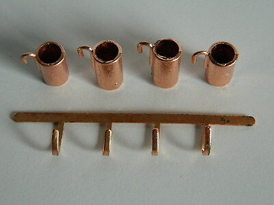 (Kp1-8) Dolls House Copper Coloured Metal Measuring Jugs And Rack