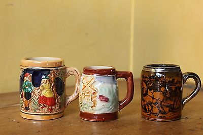 Three vintage small beer jugs.