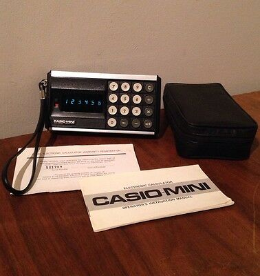 Vintage Casio-Mini Electronic Calculator With Case, Manual, And Warranty Card