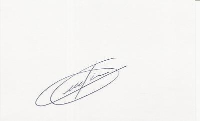 A 14 cm x 9 cm white card. Personally signed by footballer Moreno Torricelli.