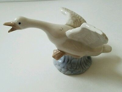Porcelain Flying Goose Figurine 7""