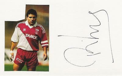 A 14 cm x 9 cm white card/pic. Personally signed by footballer Rui Barros.