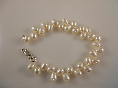White Oval Shape Freshwater Pearl Bracelet With Sterling Silver Clasp