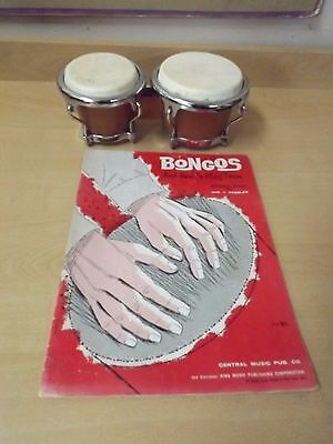 Vintage Bongo drums with book dated 1960