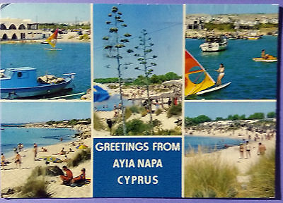 Cyprus postcard: Ayia Napa, multiple views of the beach, posted with stamps.