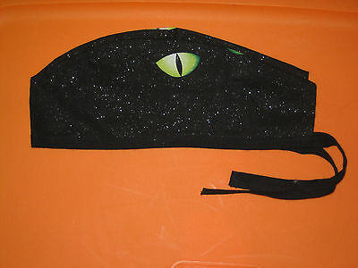 Surgical Scrub Hats/Cap Halloween Green cats eyes on sparkling black background