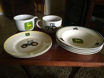 8  Pieces of John Deere Tractor by Gibson 2-salad plates, 4-soup bowls 2-mugs