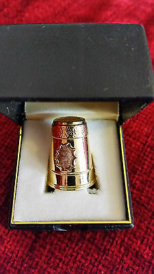 1 Gold  coloured metal thimble in presentation box