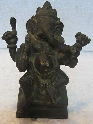 An old look solid brass sitting GANESHA hindu traditional statue