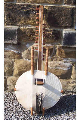 West African Kora with 21 strings. NB metal decoration pins deteriorated
