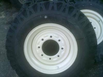 4) skid steer tire snow plowing tires and wheels, Replaces 14-17.5 tires Bobcat