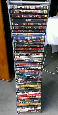40 Assorted Dvds And Tower