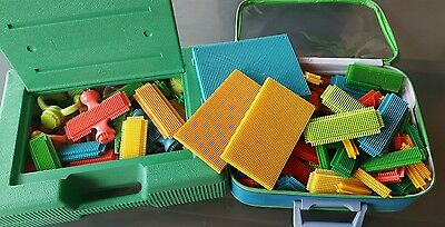 Large Selection Of Stickle Bricks In Carry Cases.
