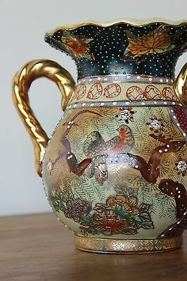Vintage Japanese Hand painted vase. Raised decoration, Deep red and gold.