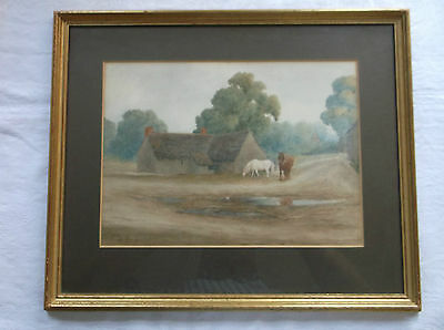 FRAMED WATERCOLOUR PAINTING by FRED D.HOW TWO HORSES WALKING THROUGH A VILLAGE