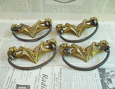 Four Vintage Brass Stamping Drawer Pulls