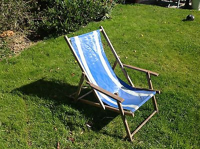 Vintage wooden deck chair with canvas seat