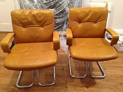 Pair of leather and chrome vintage 1960's chairs designed by Andre Vandenbueck