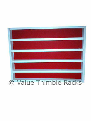 50 thimble display rack in white wood with red felt back