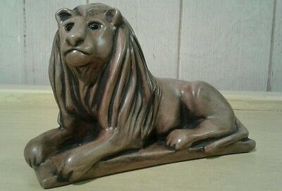 Vintage hand crafted stoneware / ceramic male lion on plinth