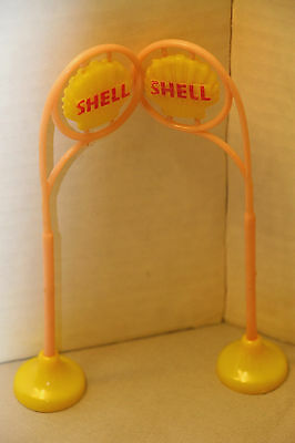 2 Vintage Toy Shell Signs