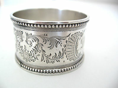Very ornate English sterling silver napkin ring w beaded edges from 1897