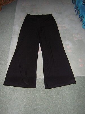 Womens / Ladies.... Black flared trousers long size 12/31 ins.inside leg