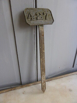 Antique metal garden plant marker number 427