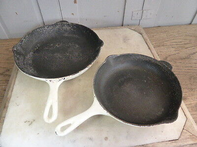 Couple vintage French white cast iron frying pans