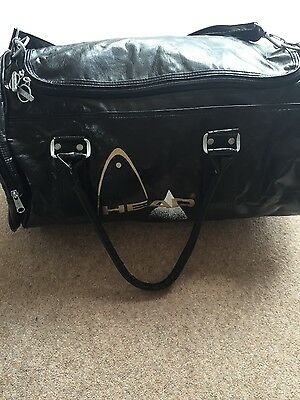 Vintage Head sports bag. Black with head logo. Handles and shoulder strap.