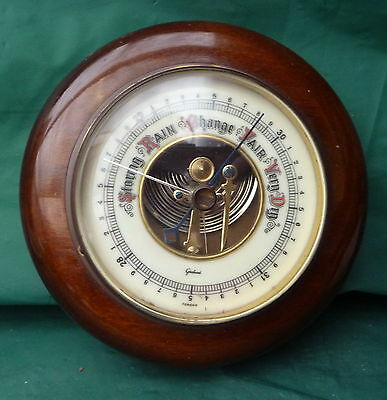 vintage round wood barometer wall display