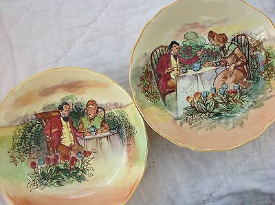 A pair of porcelain ROYAL DOULTON dishes, wine coasters : ladies & gentlemen
