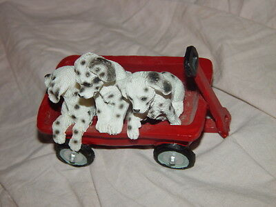 Three Dalmatians Puppies In Little Red Wagon