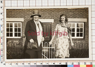 Vintage photograph two ladies posing outside a building social history