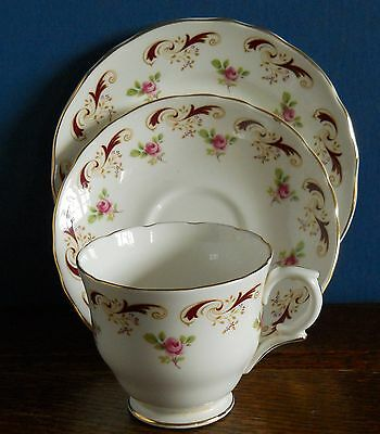 A Crown Staffordshire bone china Trio Wentworth pattern