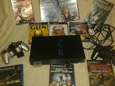 playstation 2 console and  10 games