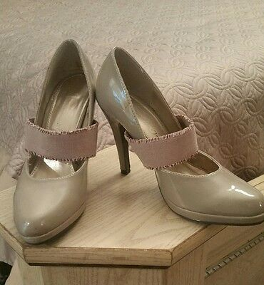 Patent leather high heel shoes size 6.5 tan