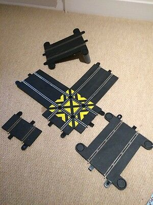 4 scalextric Pieces Cross Over, 2 Bridge Pieces And A Small Piece