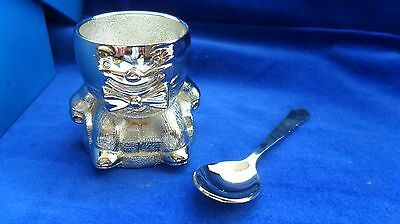 Unusual and attractive set of silver-plated eggcup & spoon in presentation box.
