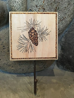 Wood burn pyrographic wall decor hanger with rustic pine cone