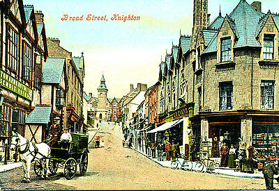 RADNORSHIRE: PC of Shops & vehicles Broad street, Knighton,  social scene,1920s?